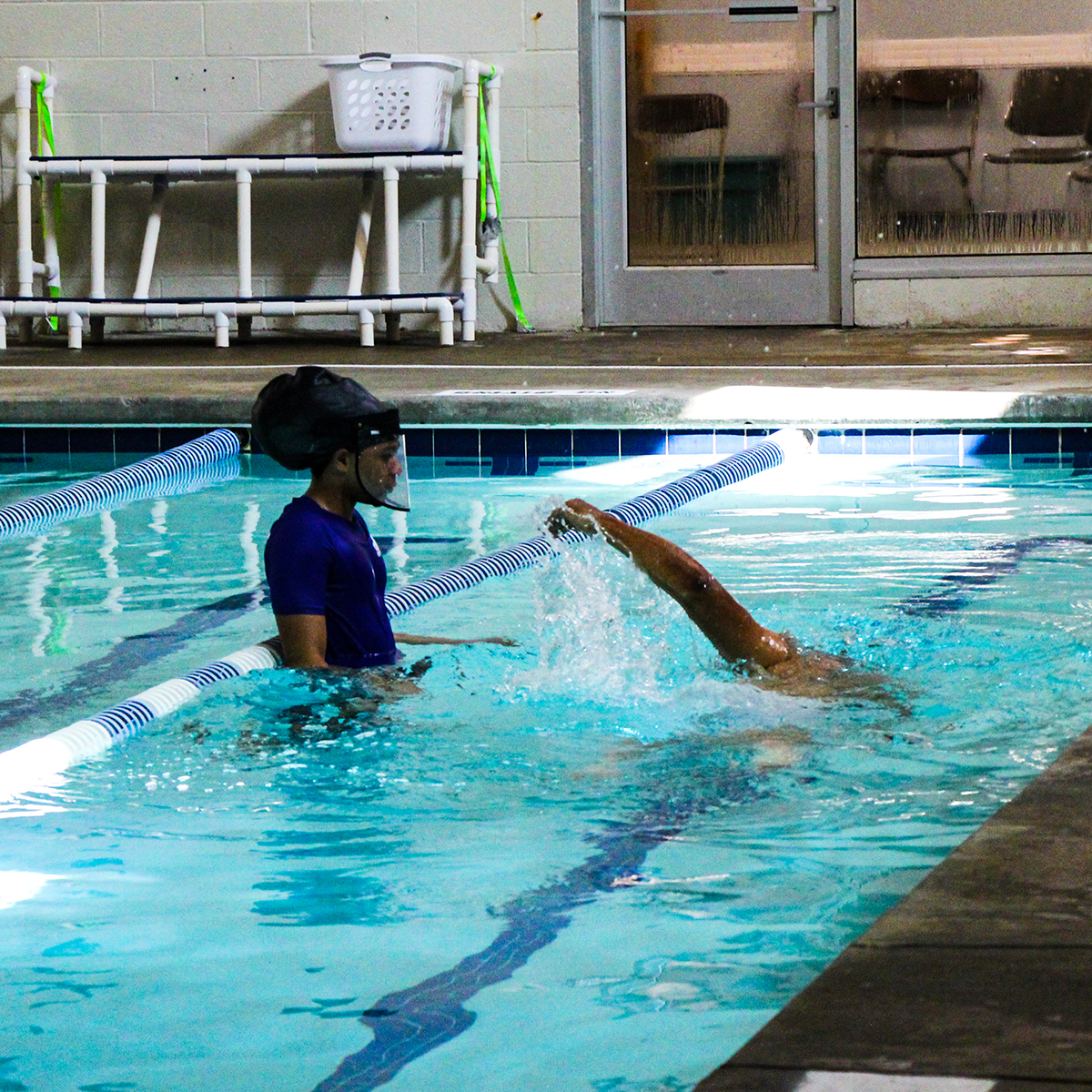 Student demonstrating freestyle stroke for instructor